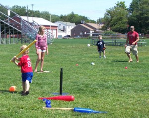 After school group playing t-ball